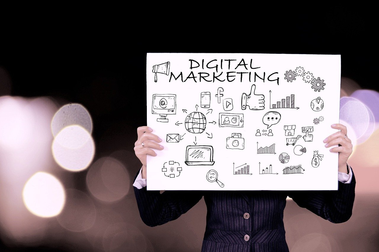 digital marketing whiteboard featuring web design and seo terms and icons